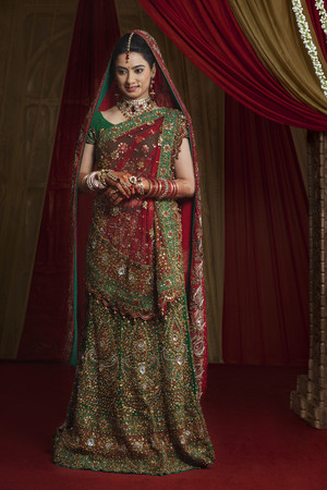 Full length of beautiful young bride standing Stock Photo