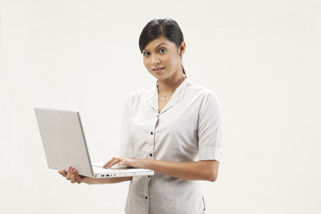 welldressed: Portrait of pretty young woman working on laptop