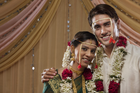 gajra: Happy bride and groom smiling together