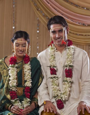 nose ring: Portrait of smiling newlywed Maharashtrian couple smiling together