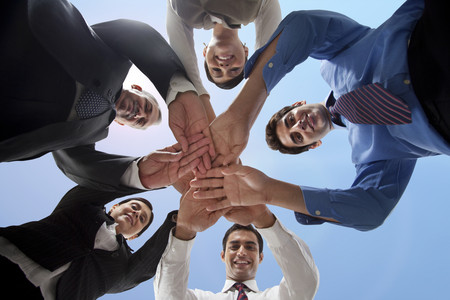 welldressed: Low angle view of business people stacking hands Stock Photo