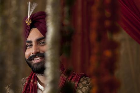kurta: Portrait of smiling groom Stock Photo