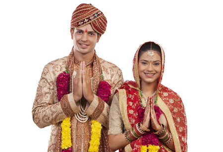 Portrait of a Gujarati bride and groom greeting