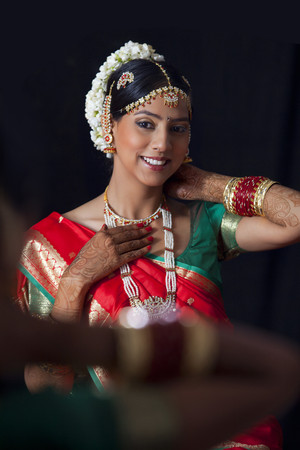 gajra: Smiling woman in traditional clothes getting ready
