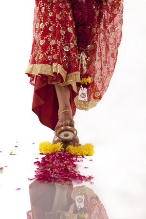 Bride entering the house of the groom