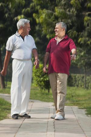 Old men smiling in a park