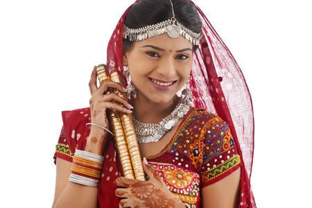 Portrait of a female dandiya dancer with sticks