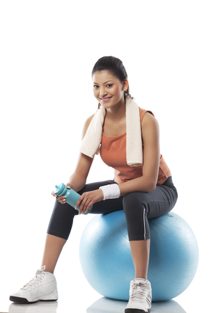 Portrait of a woman sitting on a exercise ball