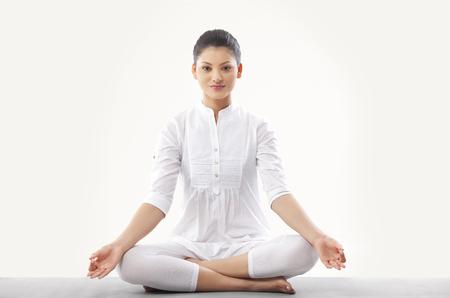 Woman doing yoga over white background Stock Photo