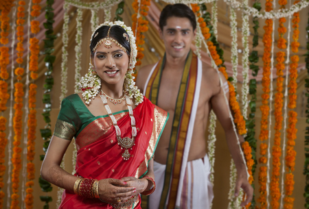 gajra: Portrait of smiling young couple on their wedding day Stock Photo