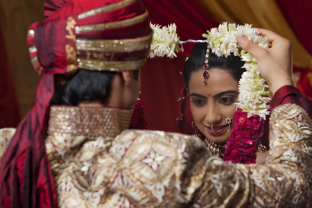 Close-up of young couple during wedding ceremony