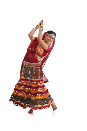 Female dandiya dancer dancing Stock Photo