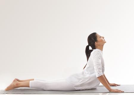 Woman practicing yoga - upward dog Stock Photo