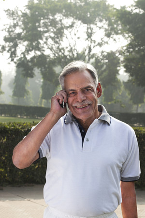 Portrait of old man talking on a mobile phone
