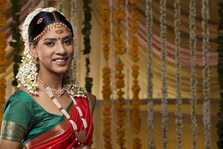 gajra: Portrait of a beautiful young bride smiling