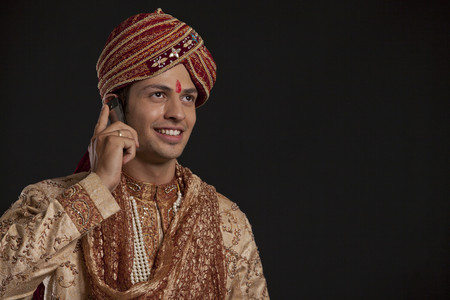 Gujarati groom talking on a mobile phone Stock Photo
