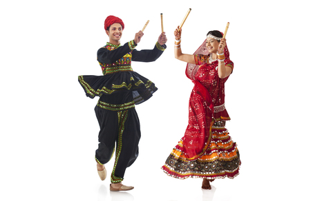 Couple performing dandia dance Stock Photo