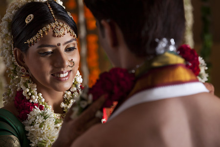 gajra: Close-up of young couple during wedding ceremony