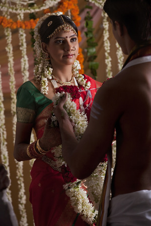 gajra: Young couple holding garlands