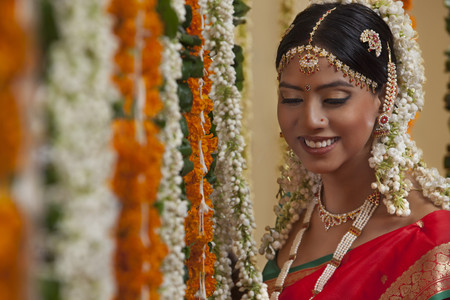 gajra: An Indian woman in traditional clothing smiling