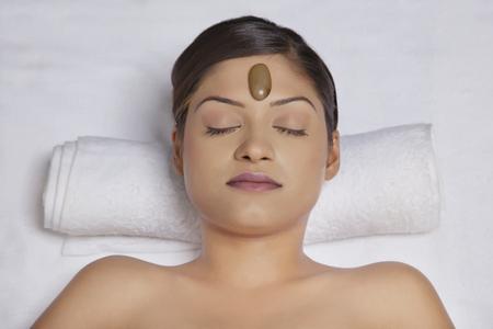 lastone therapy: Close-up of woman getting lastone treatment