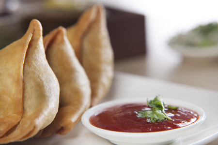 Samosa served with tomato ketchup in plate Stock Photo