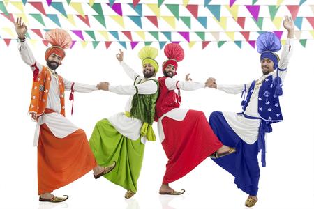 religious clothing: Sikh men dancing