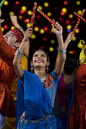 People performing dandiya Stock Photo