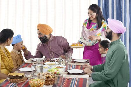 kurta: Grandfather feeding his grandson Stock Photo
