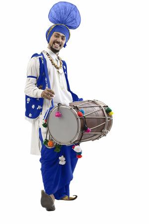 kurta: Sikh man playing on a dhol Stock Photo