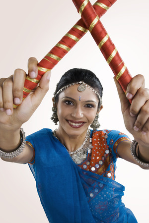 Gujarati woman performing dandiya