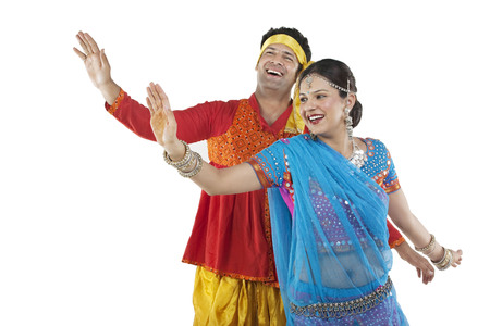 Gujarati couple dancing Stock Photo