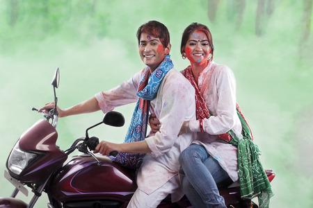 joyfulness: Couple posing on a motorcycle Stock Photo
