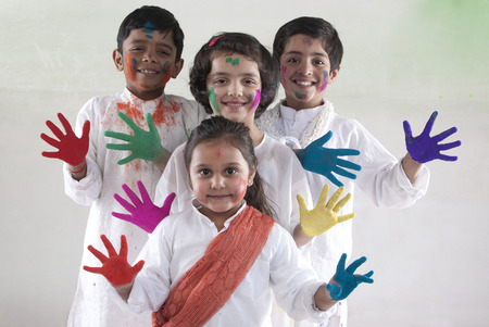 Children with coloured palms Stock Photo