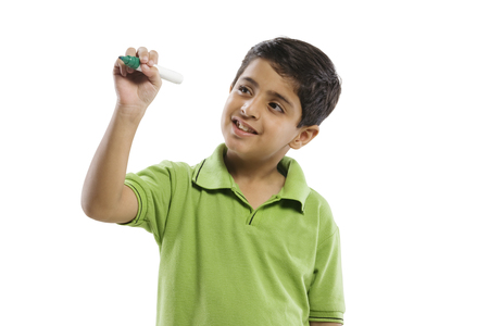 Young boy pretending to write with a marker pen