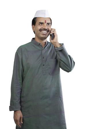 joyfulness: Man talking on a mobile phone