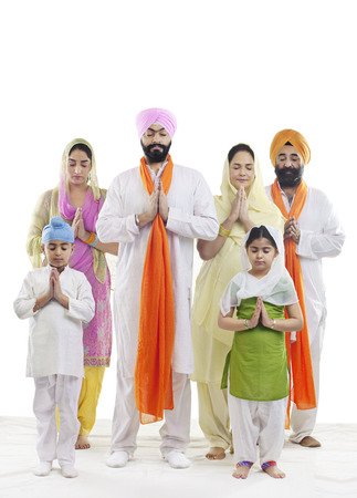 the grand daughter: Sikh family praying
