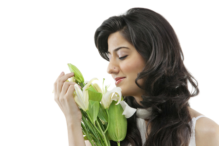A beautiful woman holding flowers Stock Photo