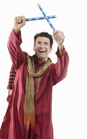 joyfulness: Gujarati man with dandiya sticks