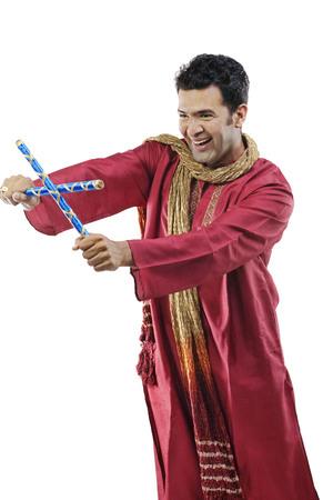 kurta: Gujarati man with dandiya sticks