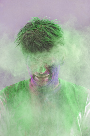 messy clothes: Man covered in holi colours