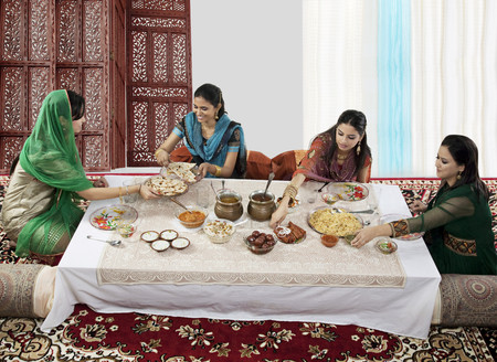 joyfulness: Muslim women having food during Id Stock Photo