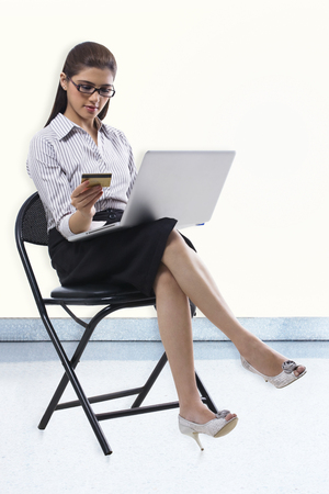 Secretary with a credit card and laptop Stock Photo