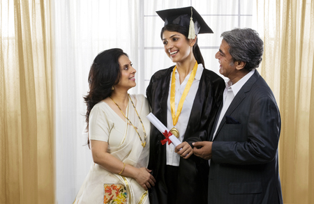 Parents congratulating their graduated daughter Stok Fotoğraf