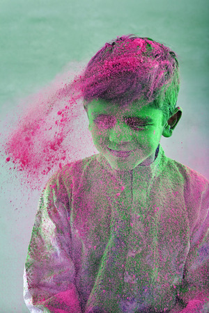 Boy covered with holi colour