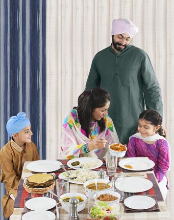 kurta: Mother serving her daughter some food