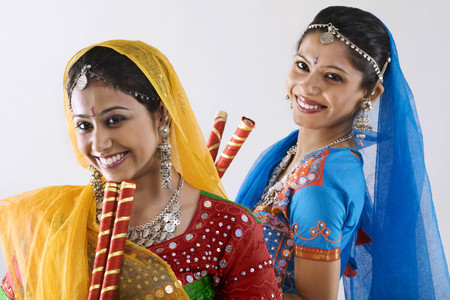 Gujarati women with dandiya sticks Stock Photo