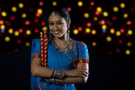 Gujarati woman with dandiya sticks