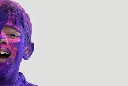 joyfulness: Boy covered with holi colours