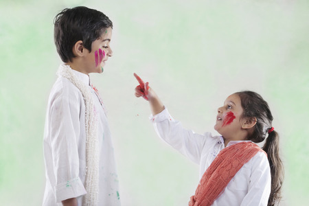 joyfulness: Girl pointing at a boy